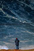 6th January 2018, Praia do Norte, Nazaré , Portugal;  A spectator observes the giant waves near the lighthouse