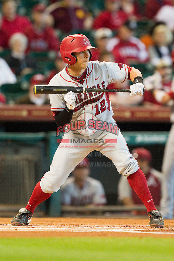 Bo Bigham #12 of the Arkansas Razorbacks squares to bunt against the Houston Cougars at Minute Maid Park on March 3, 2012 in Houston, Texas.  The Cougars defeated the Razorbacks 4-1.  (Brian Westerholt/Four Seam Images)