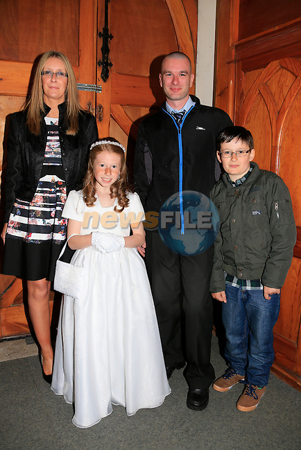 Niamh Bonnar Laura Niall and Adam at first communion in Clogherhead church.<br /> Picture www.newsfile.ie