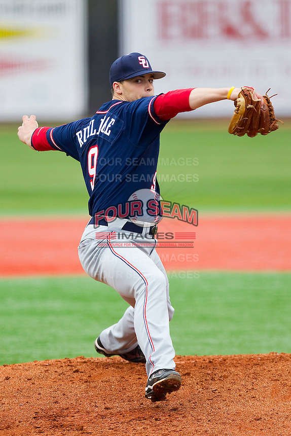 Starting pitcher Lex Rutledge #9 of the Samford Bulldogs in action against the Elon Phoenix at Latham Park on March 26, 2011 in Elon, North Carolina.  Rutledge struck out a career high 13 batters over 7 innings as the Bulldogs defeated the Phoenix 11-0.  Photo by Brian Westerholt / Four Seam Images