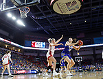 SIOUX FALLS, SD - MARCH 10: Megan Bultsma #50 of the South Dakota State Jackrabbits eyes the basket past Hannah Sjerven #34 of the South Dakota Coyotes during the women's championship game at the 2020 Summit League Basketball Tournament in Sioux Falls, SD. (Photo by Richard Carlson/Inertia)
