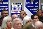 Nevada rancher Cliven Bundy, center, listens to testimony on a bill challenging federal control of Nevada public lands in a hearing at the Legislative Building in Carson City, Nev., on Tuesday, March 31, 2015. Bundy garnered national attention a year ago when he and armed supporters engaged in a showdown with federal authorities. <br /> Photo by Cathleen Allison