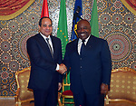 Egyptian President Abdel Fattah al-Sisi shakes hands with Gabon's President Ali Bongo Ondimba in Libreville on August 16, 2017. Photo by Egyptian President Office