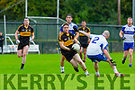 Chris Brady Dr Crokes goes past Desmond's Barry Lynch during their County League Div 1 clash in Lewis Road on Sunday