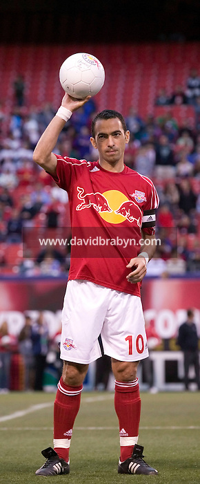 20 May 2006 - East Rutherford, NJ - French soccer player Youri Djorkaeff salute the crowd before a championship match between his New York Redbulls team and the Los Angeles Chivas at Giants Stadium, East Rutherford, USA, 20 May 2006. The New York Redbulls won the game 5-3 in their first victory of the season. Photo Credit: David Brabyn