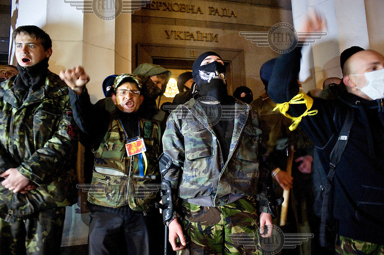 Pravyi Sektor (Right Sector) activists on guard in front of the Verkhovna Rada (Supreme Council of Ukraine). Protests against the government of President Viktor Yanukovych were sparked on 21 November 2013 by the Ukrainian government's decision to suspend preparations for the signing of an association agreement with the European Union that would have increased trade with the EU. Some believe that the U-turn came about as a result of pressure from President Putin of Russia who wants Ukraine to join a customs union with itself, Kazakhstan and Belarus. Russia offered 15 billion dollars of soft loans and reduced price gas to Ukraine at the same time as discussions with the EU were taking place. After weeks of protests and a number of deaths, Prime Minister Mykola Azarov and the entire cabinet resigned. On 18 February, after Yanukovych's party scuppered a move to change the constitution to reduce the powers of the president, renewed fighting between protesters and police broke out and had cost the lives of around 80 people by Friday 21st February. By 22 February Yanukovych had fled Kiev. In the days following the Ukrainian parliament decided to strip him of the presidency.