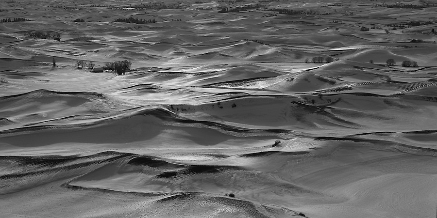 Ice covers the snow on the hillsides of the Palouse farmland as seen in winter.