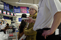 Moscow, Russia, 03/01/2004..A salesman demonstrates a television to a customer at the Mosmart shopping mall.