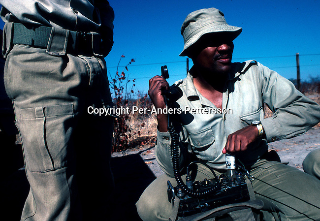 An unidentified officer with a Botswana wildlife anti-poaching unit contacting headquarters on a radio on November 12, 1996 in the Okavango Delta outside Maun, Botswana. The unit combats illegal poaching in the park, specially the poaching of elephants and rhino. An  international ban on the sale of ivory is supported by the country..Photo: Per-Anders Pettersson/ Getty Images