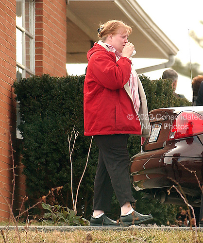 Buckhannon, WVa - January 8, 2006 -- Unidentified woman sobbs as she leaves the funeral home following the funeral of Jesse L. Jones, 44, in Buckhannon, West Virginia on January 8, 2006.   Mr. Jones perished in the Sago Mine explosion on January 2, 2006..Credit: Ron Sachs / CNP