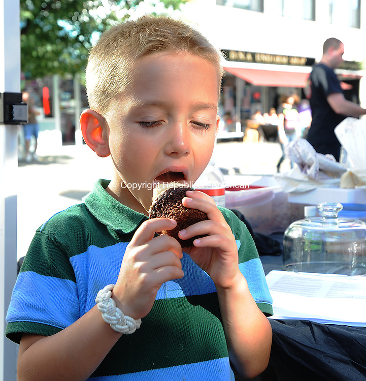 TORRINGTON, CT-05 JULY 2012--070512JS09- Antonio Caldareri, 5, of Torrington, enjoys a chocolate chip cookie dough cupcake from Hardcore Street Custom Cupcakes from Waterbury during Main Street Marketplace in Torrington on Thursday. .Jim Shannon Republican-American