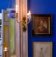 A detail highlighting an antique gilded sconce in the living room of a house in St Petersburg