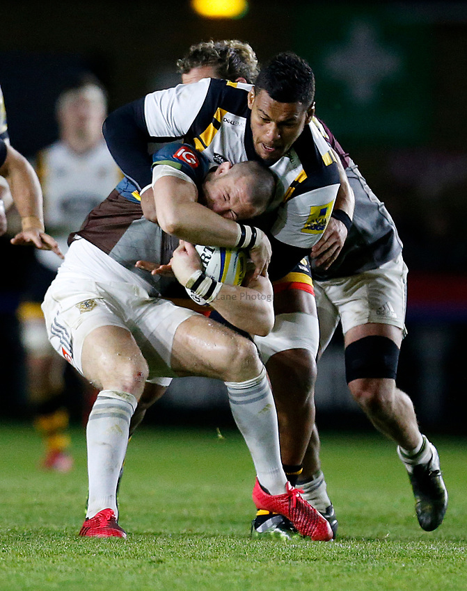 Photo: Richard Lane/Richard Lane Photography. Aviva Premiership. Harlequins v Wasps. 28/04/2017. Quins' Mike Brown is tackled by Wasps' Nathan Hughes.
