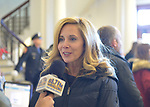 Mineola, New York, USA. January 1, 2018. Town of Hempstead Supervisor LAURA GILLEN, a Democrat, is interviewed by a reporter for Hofstra University's WRHU radio station, after historic swearing-In of Laura Curran as Nassau County Executive. They were in the Theodore Roosevelt Executive & Legislative Building, which the Curran swearing-in was held in front of the entrance outdoors. Gillen's swearing in was held that morning at Hofstra University.