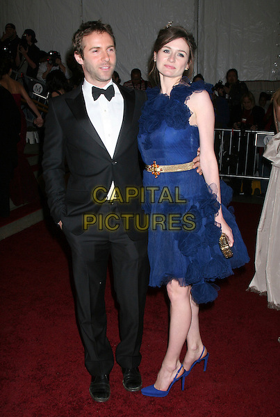 "ALESSANDRO NIVOLA & EMILY MORTIMER.Metropolitan Museum of Art Costume Institute Gala celebrating ""Poiret: King of Fashion"" exibition at the Metropolitan Museum of Art, New York City, New York, USA. .May 7th, 2007.full length blue dress shoes gold belt gathered material corsage bunch bunched tuxedo dinner suit .CAP/IW.©Ian Wilson/Capital Pictures"