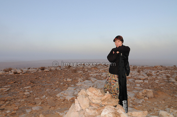 Africa, Tunisia, Tembaine. Desert traveller Doris (carrying a telescopic mast for photography) on one of the Tembaine peaks at daybreak.  --- No releases available, but releases may not be needed for certain uses. --- Info: Image belongs to a series of photographs taken on a journey to southern Tunisia in North Africa in October 2010. The trip was undertaken by 10 people driving 5 historic Series Land Rover vehicles from the 1960's and 1970's. Most of the journey's time was spent in the Sahara desert, especially in the area around Douz, Tembaine, Ksar Ghilane on the eastern edge of the Grand Erg Oriental.