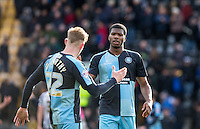 Rowan Liburd (Loanee from Reading) of Wycombe Wanderers & Jason McCarthy of Wycombe Wanderers shake hands during the Sky Bet League 2 match between Notts County and Wycombe Wanderers at Meadow Lane, Nottingham, England on 28 March 2016. Photo by Andy Rowland.