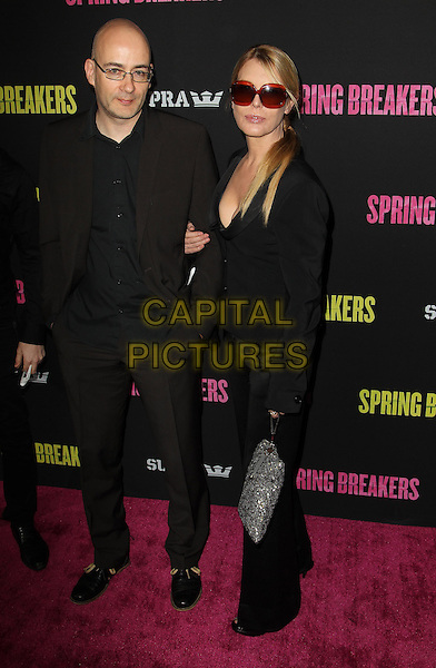 Guest & Deborah Kara Unger.At the 'Spring Breakers' Los Angeles Premiere Held At The ArcLight Cinerama Dome,  Hollywood, California, USA, 14th March 2013..full length black trousers jacket sunglasses red silver bag .CAP/ADM/KB.©Kevan Brooks/AdMedia/Capital Pictures.
