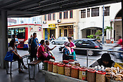 Locals wait at a bus-stand in capital Georgetown of Penang, Malaysia. Photo: Sanjit Das/Panos