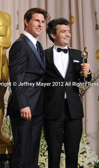 HOLLYWOOD, CA - FEBRUARY 26: Tom Cruise and Thomas Langmann pose in the press room at the 84th Annual Academy Awards held at Hollywood & Highland Center on February 26, 2012 in Hollywood, California.