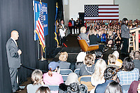 Democratic presidential candidate and former First Lady and Secretary of State Hillary Rodham Clinton (seated) waits to be introduced at the Women's Economic Opportunity Summit at Southern New Hampshire University in Hooksett, New Hampshire.