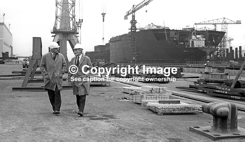 Lord Rochdale, outgoing chairman, Harland &amp; Wolff shipyard, Belfast, N Ireland, left, briefs his successor, Sir Brian Morton, during a tour of the shipbuilding complex. 4th November 1975. 197511040713LR4<br /> <br /> Copyright Image from Victor Patterson, 54 Dorchester Park, Belfast, UK, BT9 6RJ<br /> <br /> t: +44 28 90661296<br /> m: +44 7802 353836<br /> vm: +44 20 88167153<br /> e1: victorpatterson@me.com<br /> e2: victorpatterson@gmail.com<br /> <br /> For my Terms and Conditions of Use go to www.victorpatterson.com