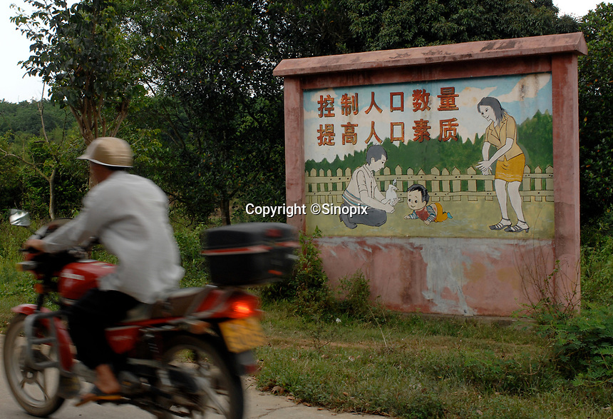 Propaganda posters in the country-side in Danzhou County,  Hainan Island, China,  25th April 2007. Danzhou has the highest gender inbalance in China with 170 males born for every 100 females according to figures from Chinese Government 5t National Census. The inbalance is already having a massive social impact on society and is expected to get worse while the ruthless One Child Policy, aimed at curbingChina's 1.3 billion population, continues to be law.  The rea is beggining to rigidly enforce the policy due to the massive problem of gender selection.