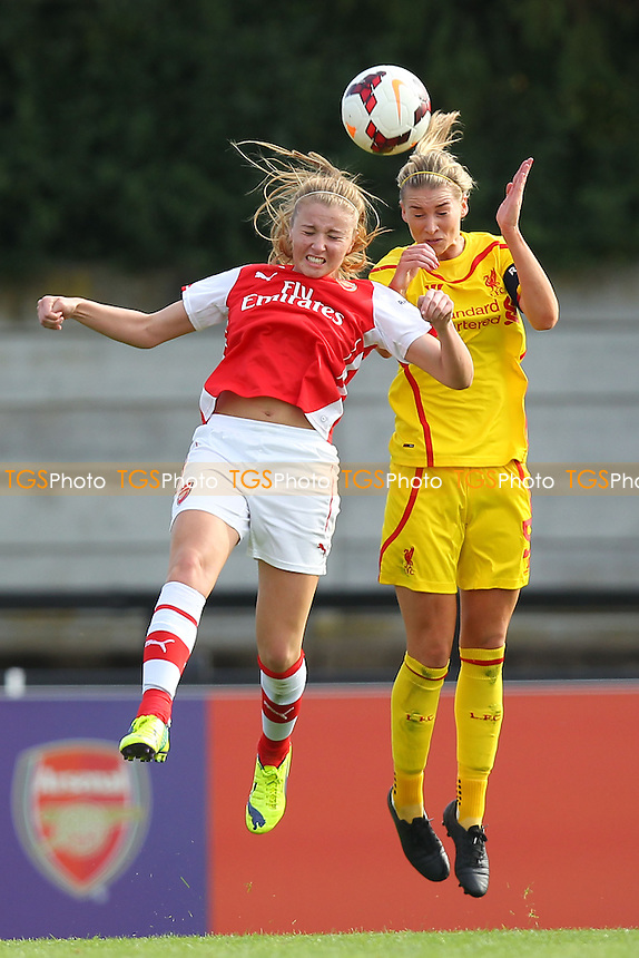 Gemma Bonner of Liverpool Ladies rises above Leah Williamson of Arsenal Ladies - Arsenal Ladies vs Liverpool Ladies - FA Womens Super League Football at Meadow Park, Boreham Wood FC  - 05/10/14 - MANDATORY CREDIT: Gavin Ellis/TGSPHOTO - Self billing applies where appropriate - contact@tgsphoto.co.uk - NO UNPAID USE