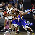 SIOUX FALLS, SD: MARCH 7: Tre'Shawn Thurman #15 from Omaha tries to spin out of a double team from Tevin King #2 and Mike Daum #24 from South Dakota State during the Men's Summit League Basketball Championship Game on March 7, 2017 at the Denny Sanford Premier Center in Sioux Falls, SD. (Photo by Dick Carlson/Inertia)