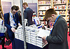 Conservative Party Conference <br /> Manchester, Great Britain <br /> Day 3<br /> 6th October 2015 <br /> <br /> Delegates reading Call Me Dave in the exhibition bookshop <br /> <br /> <br /> Photograph by Elliott Franks <br /> Image licensed to Elliott Franks Photography Services