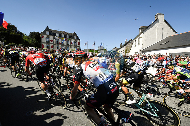 The peloton including Dan Martin (IRL) UAE Team Emirates fly by during Stage 6 of the 2018 Tour de France running 181km from Brest to Mur-de-Bretagne Guerledan, France. 12th July 2018. <br /> Picture: ASO/Bruno Bade | Cyclefile<br /> All photos usage must carry mandatory copyright credit (© Cyclefile | ASO/Bruno Bade)