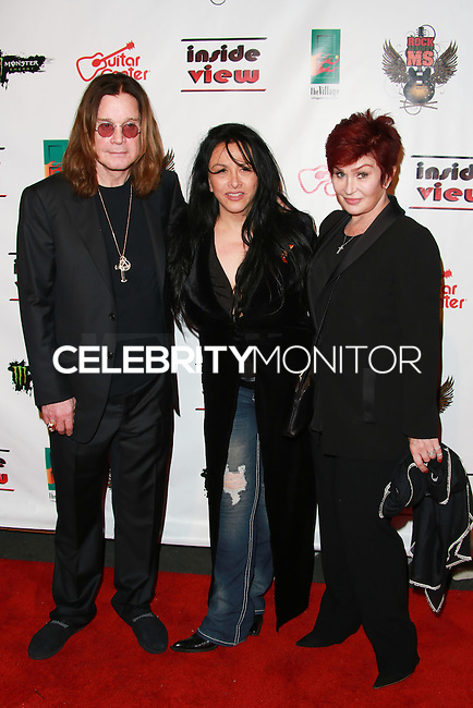 LOS ANGELES, CA, USA - OCTOBER 26: Ozzy Osbourne, Nancy Sayle, Sharon Osbourne arrive at An Evening Of Art With Billy Morrison And Joey Feldman Benefiting The Rock Against MS Foundation held at Village Studios on October 26, 2014 in Los Angeles, California. (Photo by David Acosta/Celebrity Monitor)