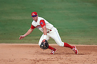 Clearwater Threshers first baseman Rhys Hoskins (25) makes a play on a ball during the first game of a doubleheader against the Jupiter Hammerheads on July 25, 2015 at Bright House Field in Clearwater, Florida.  Jupiter defeated Clearwater 8-5.  (Mike Janes/Four Seam Images)