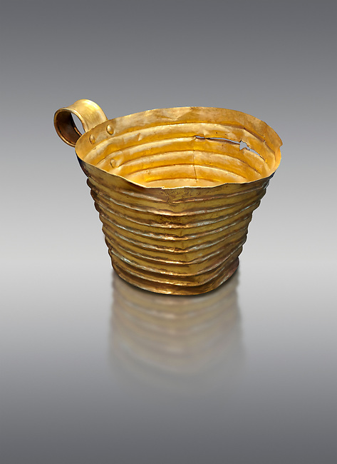 Mycenaean gold cup with horizontal grroves, Grave IV, Grave Circle A, Mycenae, Greece. National Archaeological Museum of Athens.  Grey Background<br /> <br /> <br /> An elegant precious gold cup hammered from thick gold to created a simple elegant design. This Mycenaean gold cup demonstrates how advance Mycenaean metalworking was in the 16th century BC. The value of the cup would have been extermely high so must have graced the table of a Mycenaean noble perhaps even a v king.
