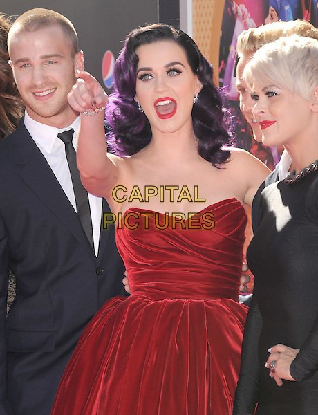 "Katy Perry.""Katy Perry: Part Of Me"" Los Angeles Premiere held at Grauman's Chinese Theatre, Hollywood, California, USA..June 26th, 2012.half length red strapless velvet dress hand arm mouth open    dyed purple hair                                         .CAP/RKE/DVS.©DVS/RockinExposures/Capital Pictures."