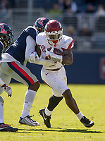 Hawgs Illustrated/BEN GOFF <br /> T.J. Hammonds, Arkansas running back, tries to break the tackle of D.D. Bowie, Ole Miss cornerback, on a run in the third quarter Saturday, Oct. 28, 2017, at Vaught-Hemingway Stadium in Oxford, Miss.