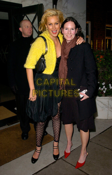 "ALICE EVANS & GUEST.At the UK Premiere of ""Amazing Grace"",.Curzon Mayfair Cinema, London, England,.March 19th 2007..full length yellow cropped jacket black dress leggings.CAP/CAN.©Can Nguyen/Capital Pictures"