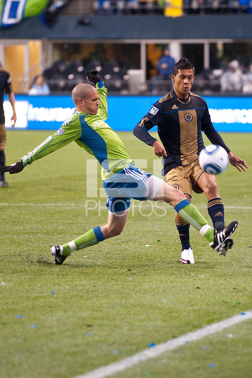 Osvaldo Alonso (l) and Michael Orozco (r) fight for the ball as the Seattle Sounders defeated the Philadelphia Union, 2-0, in an MLS match on Thursday, March 25, 2010 at Qwest Field in Seattle, WA. It was the Sounders home opener and the first regular season game for the expansion Philadelphia Union.