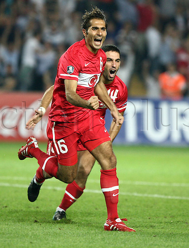 07.09.2010 Turkey made it two wins out of two Euro 2012 qualifying Group A thanks to a thrilling victory over battling 10-man Belgium in Istanbul. Picture shows Hamit Altintop and Arda Turan of Turkey