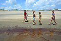 Public beaches were closed today as oil and dead fish and birds washed ashore at Grand Isle, La., Friday, May 21, 2010.
