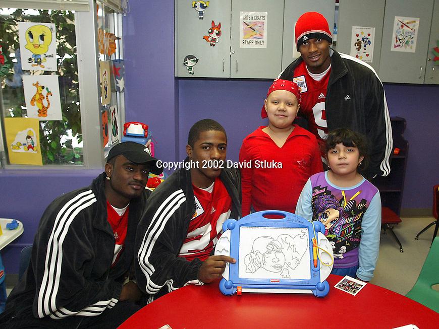 University of Wisconsin teammates visit the Children's Hospital in San Antonio, Texas, on 12/26/02. (Photo by David Stluka)