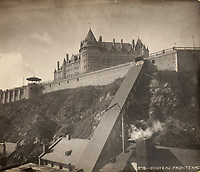 Funicular, Dufferin Terrace and the Chateau Frontenac, photograph, 1920, from the Archives of the Quebec Seminary, in the Musee de la Civilisation, or Museum of Civilisation, Quebec City, Quebec, Canada. The Chateau Frontenac, opened 1893, was designed by Bruce Price as a chateau style hotel for the Canadian Pacific Railway company or CPR, in Quebec City, Quebec, Canada. It is now a hotel, the Fairmont Le Chateau Frontenac, and is listed as a National Historic Site of Canada. The Historic District of Old Quebec is listed as a UNESCO World Heritage Site. Picture by Manuel Cohen