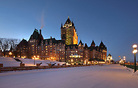 Chateau Frontenac, opened 1893, designed by Bruce Price as a chateau style hotel for the Canadian Pacific Railway company or CPR, seen in the evening from the Dufferin Terrace, in Quebec City, Quebec, Canada. The building was extended and the central tower added in 1924, by William Sutherland Maxwell. The building is now a hotel, the Fairmont Le Chateau Frontenac, and is listed as a National Historic Site of Canada. The Historic District of Old Quebec is listed as a UNESCO World Heritage Site. Picture by Manuel Cohen