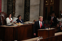 Speaker of the United States House of Representatives Nancy Pelosi (Democrat of California), left, follows the text as US President Donald J. Trump delivers his second annual State of the Union Address to a joint session of the US Congress in the US Capitol in Washington, DC on Tuesday, February 5, 2019.<br /> Credit: Alex Edelman / CNP