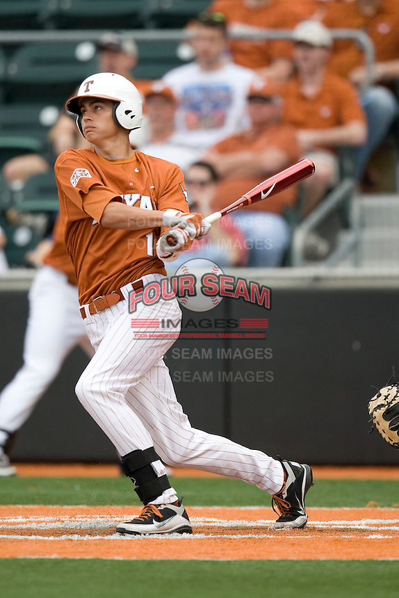 Texas OF Cohl Walla (1) follows through against Stanford on March 4th, 2011 at UFCU Disch-Falk Field in Austin, Texas.  (Photo by Andrew Woolley / Four Seam Images)