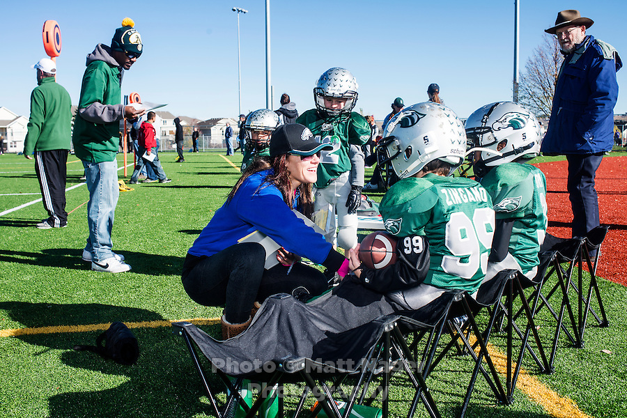 MMA fighter Cat Zingano (cq) watches her son, Brayden Zingano (cq, age 8) play football in Parker, Colorado, Saturday, November 8, 2014. In 2013, Zingano became the first woman to win a UFC fight by technical knockout and is currently the number three ranked pound-for-pound female MMA fighter in the world.<br /> <br /> Photo by Matt Nager