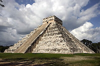 "The Pyramid of Kukulcan, called El Castillo (The Castle), 26 meters high, square base of 55,5 meters per side, each of the four sides, which represent the four cardinal points, is ""cut"" in two by a staircase with 91 steps, Toltec architecture, 1100-1300 AD, Chichen Itza, Yucatan, Mexico. Picture by Manuel Cohen"