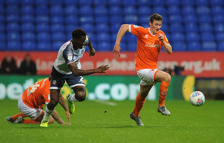 Blackpool's Matty Virtue under pressure from Bolton Wanderers' Josh Emmanuel<br /> <br /> Photographer Kevin Barnes/CameraSport<br /> <br /> The EFL Sky Bet League One - Bolton Wanderers v Blackpool - Monday 7th October 2019 - University of Bolton Stadium - Bolton<br /> <br /> World Copyright © 2019 CameraSport. All rights reserved. 43 Linden Ave. Countesthorpe. Leicester. England. LE8 5PG - Tel: +44 (0) 116 277 4147 - admin@camerasport.com - www.camerasport.com