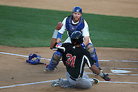 Paul Hoenecke (19) of the Rancho Cucamonga Quakes tags out Ronald Guzman (31) of the High Desert Mavericks at home plate during a game at LoanMart Field on August 18, 2015 in Rancho Cucamonga, California. High Desert defeated Rancho Cucamonga, 4-0. (Larry Goren/Four Seam Images)
