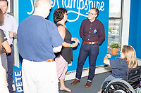 Chasten Buttigieg, husband of Democratic presidential candidate and South Bend, Ind., mayor Pete Buttigieg, greets people at the opening kickoff of a Buttigieg campaign office downtown in Concord, New Hampshire, on Thu., September 5, 2019.